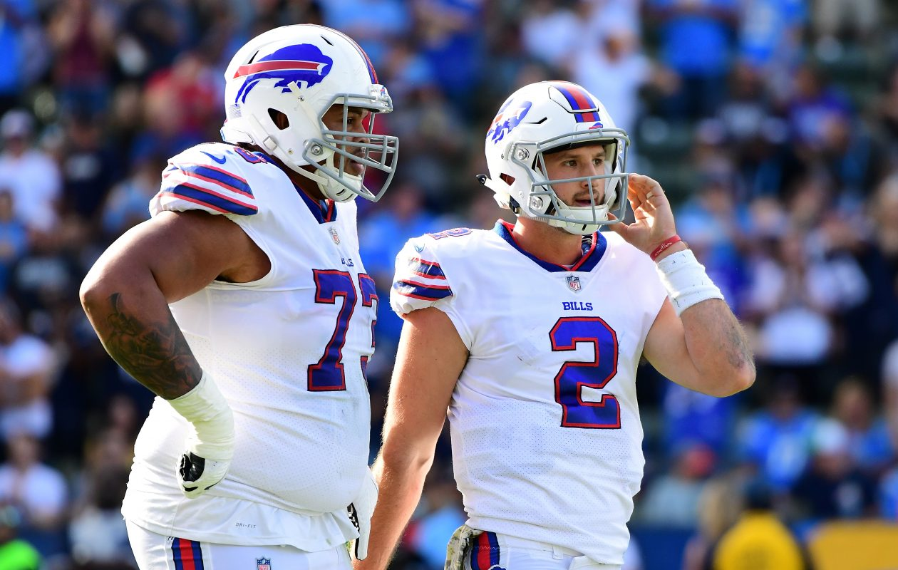Nathan Peterman of the Buffalo Bills reacts alongside Dion Dawkins of the Buffalo Bills after throwing his second interception during the game against the Los Angeles Chargers. (Getty Images)
