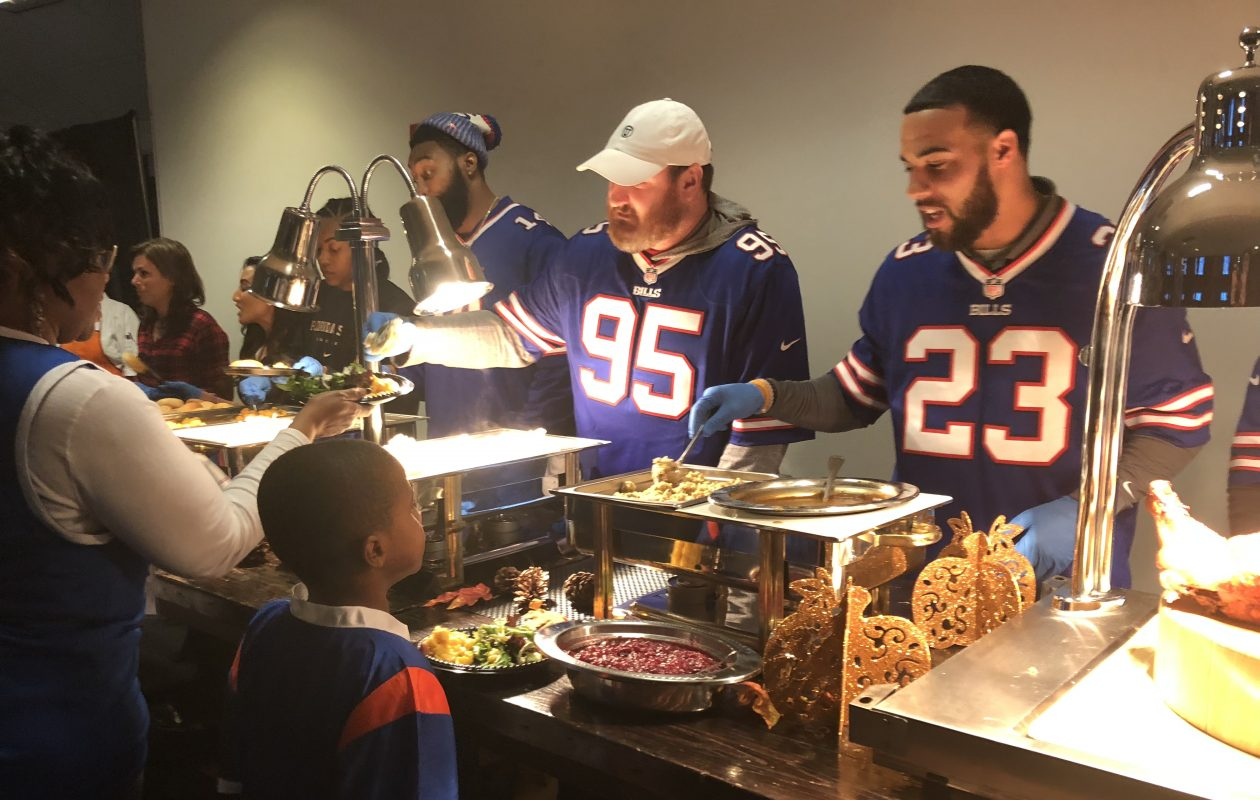 Buffalo Bills players Micah Hyde, Kyle Williams and Joe Webb helped serve Thanksgiving dinners to children from four community centers in the press box at New Era Field on Tuesday, Nov. 21, 2017. (Photo courtesy of Buffalo Bills)