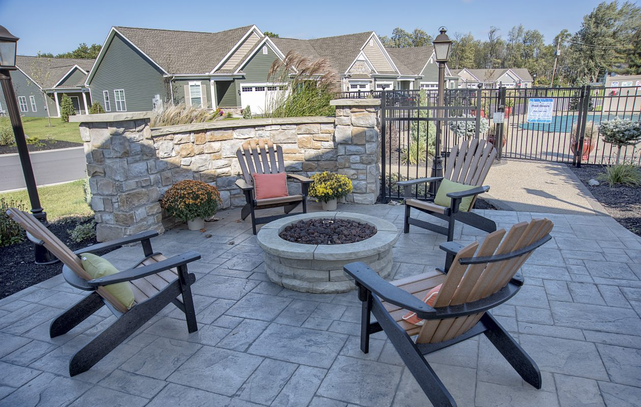 Residents enjoy use of the clubhouse with its pool and firepit.