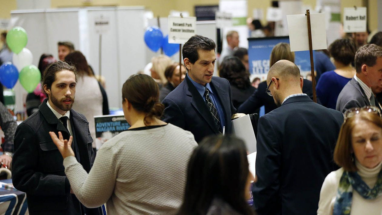 Job seekers talk to prospective employers during the Jobsapalooza career fair at the Buffalo Niagara Marriott in Amherst earlier this year. (Derek Gee/News file photo)