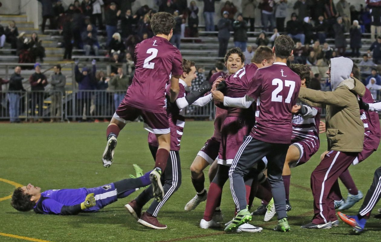 St. Joe's celebrates after beating Canisius in the Monsignor Martin boys soccer championship game in penalty kicks Monday at Canisius College (Robert Kirkham/Buffalo News)