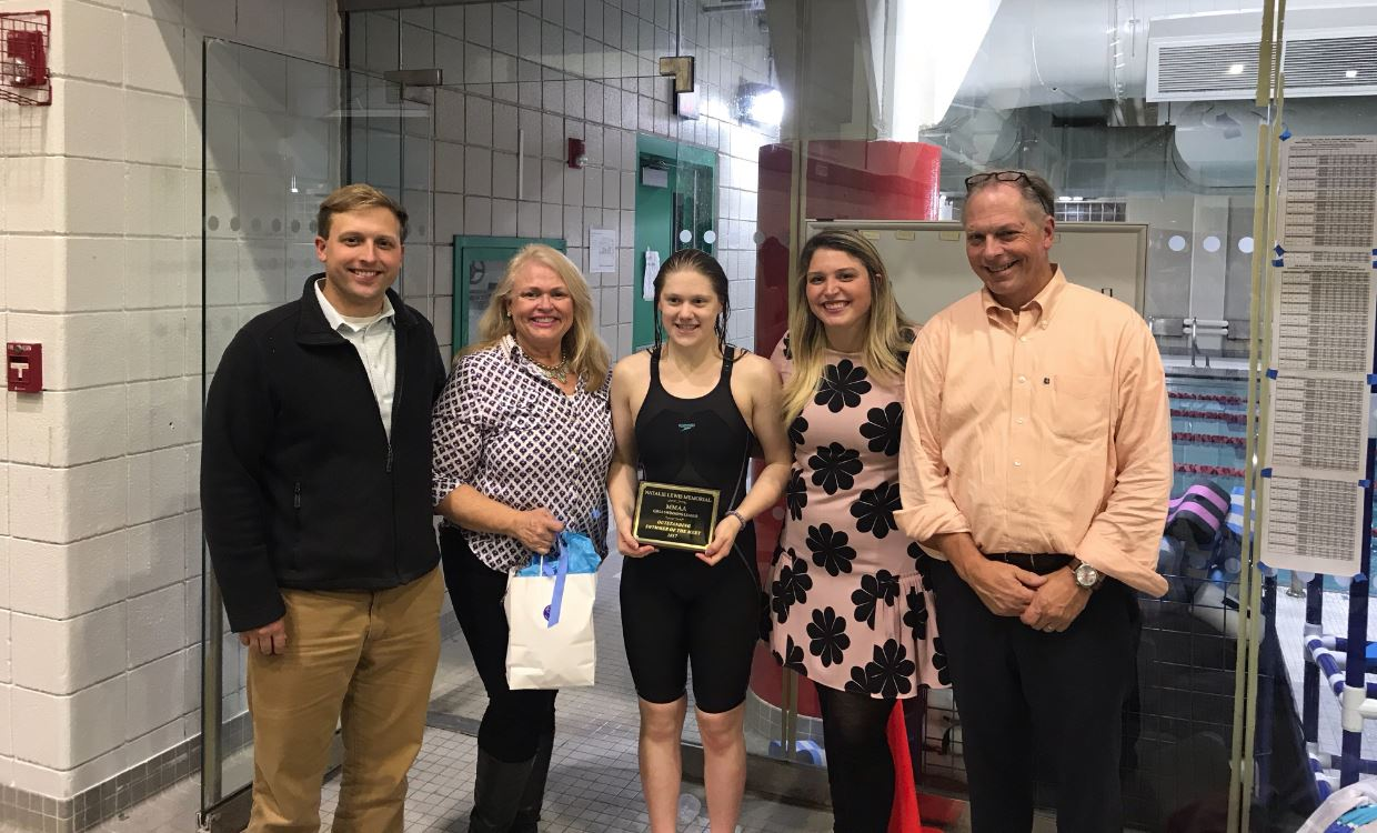 Sacred Heart's Abby Halsdorfer with the family of Natalie Lewis as she was named the Natalie Lewis Memorial Most Outstanding Swimmer. From left: Evan Jr., Trish, Halsdorfer, Caroline and Evan Sr. (Photo courtesy of Barbara Rooney)
