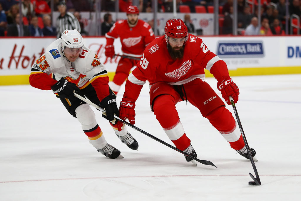 Detroit forward Luke Witkowski works the puck against Calgary's Sam Bennett on Wednesday. Witkowski earned a 10-game suspension for his role during a third-period brawl in the game (Getty Images).