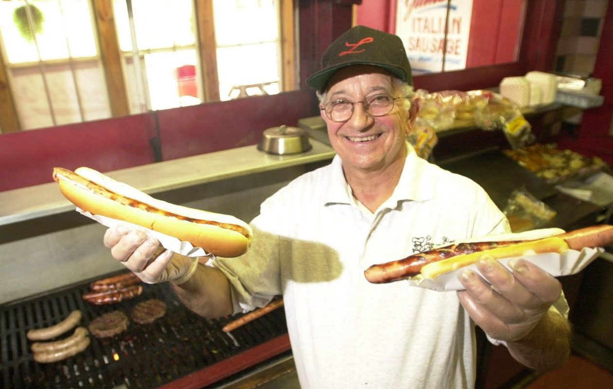 Louie's founder Louis Turco, pictured in 2001, holding his signature product. (Sharon Cantillon/Buffalo News)