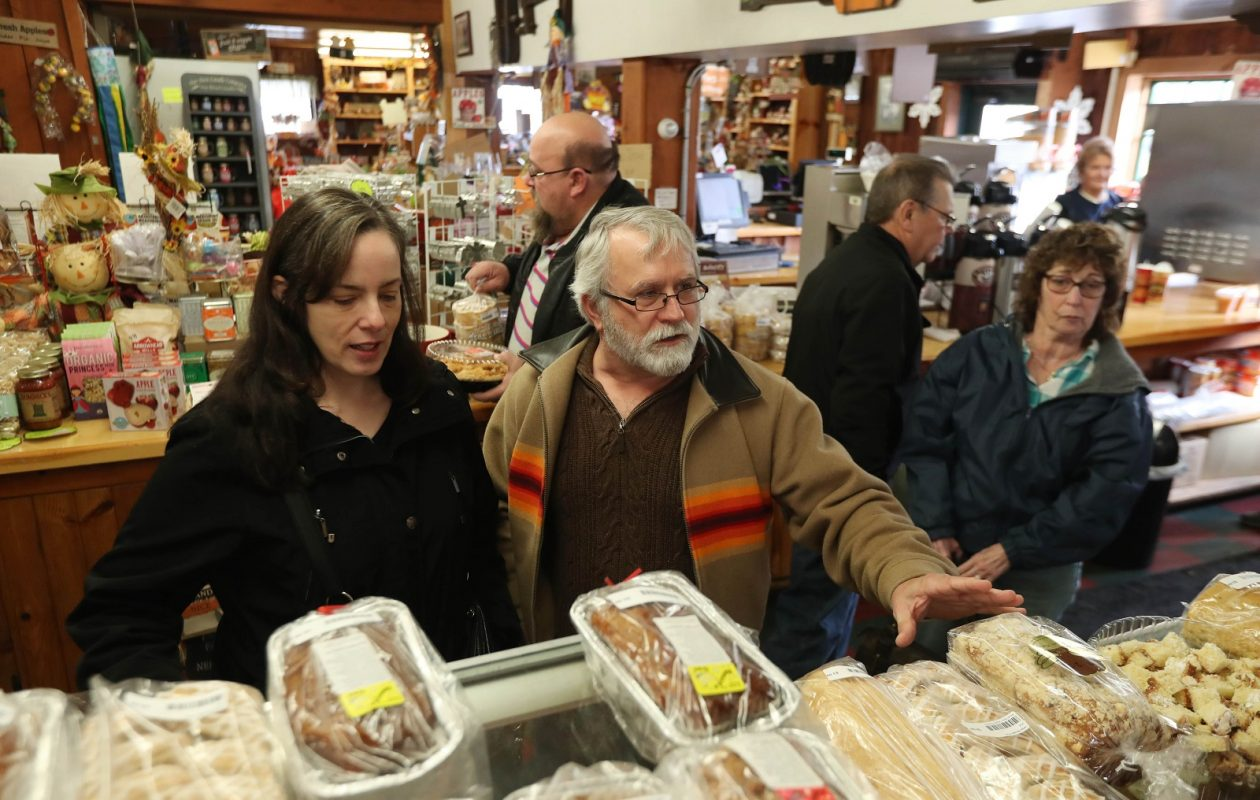 Mayer Bros. Cider Mill and Bakery buzzes with activity Thanksgiving week 2017. Linda Kasperek, of Buffalo and Fred Popeski, of Erie, Pa, pick out a dozen doughnuts.  (Sharon Cantillon/Buffalo News)