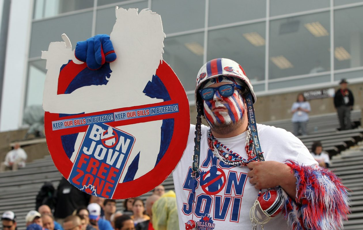 Sporting anti-Bon Jovi gear is a fan waiting for Buffalo Bills great Andre Reed to be inducted into the Pro Football Hall of Fame in Canton, Ohio on Aug. 2, 2014.  (James P. McCoy/ Buffalo News)