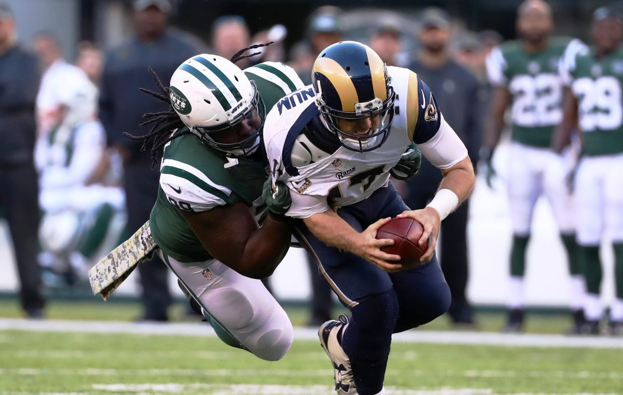 Quarterback Case Keenum of the Los Angeles Rams is sacked by Steve McLendon of the New York Jets at MetLife Stadium on Nov. 13, 2016, in East Rutherford, N.J. (Al Bello/Getty Images)