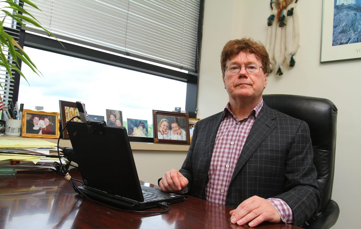 Clarence pain specialist Dr. Eugene Gosy, shown in a file photo taken at his medical office,  is accused in a new federal indictment of illegally prescribing pain medication that resulted in the six deaths, making him the first local doctor to be charged with such a crime. (News file photo)