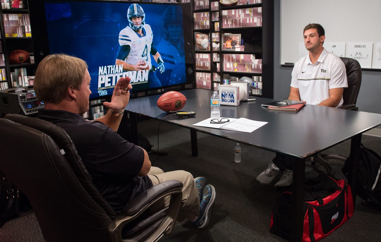 Jon Gruden and Nathan Peterman during the 2017 class at Gruden Camp. (Heather Harvey/ESPN Images)