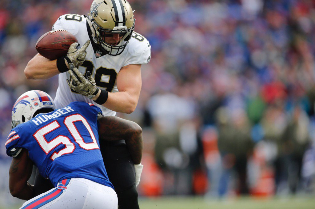 Buffalo Bills' Ramon Humber hits Saints tight end Josh Hill to force a fumble in the first quarter. (Derek Gee/Buffalo News)