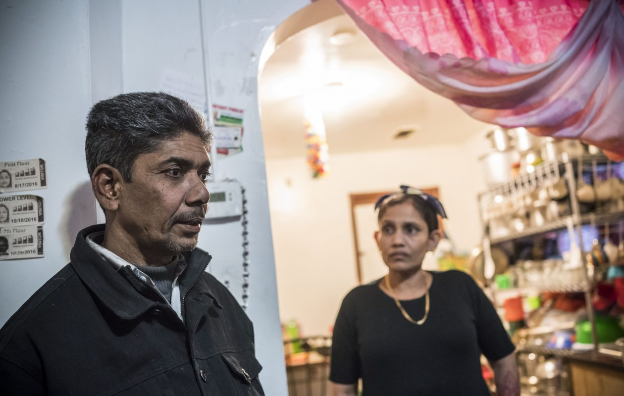 Rohingya refugees Shamsul Alam and his wife, Taslimah Binti, in their East Side Buffalo home. (Derek Gee/Buffalo News)