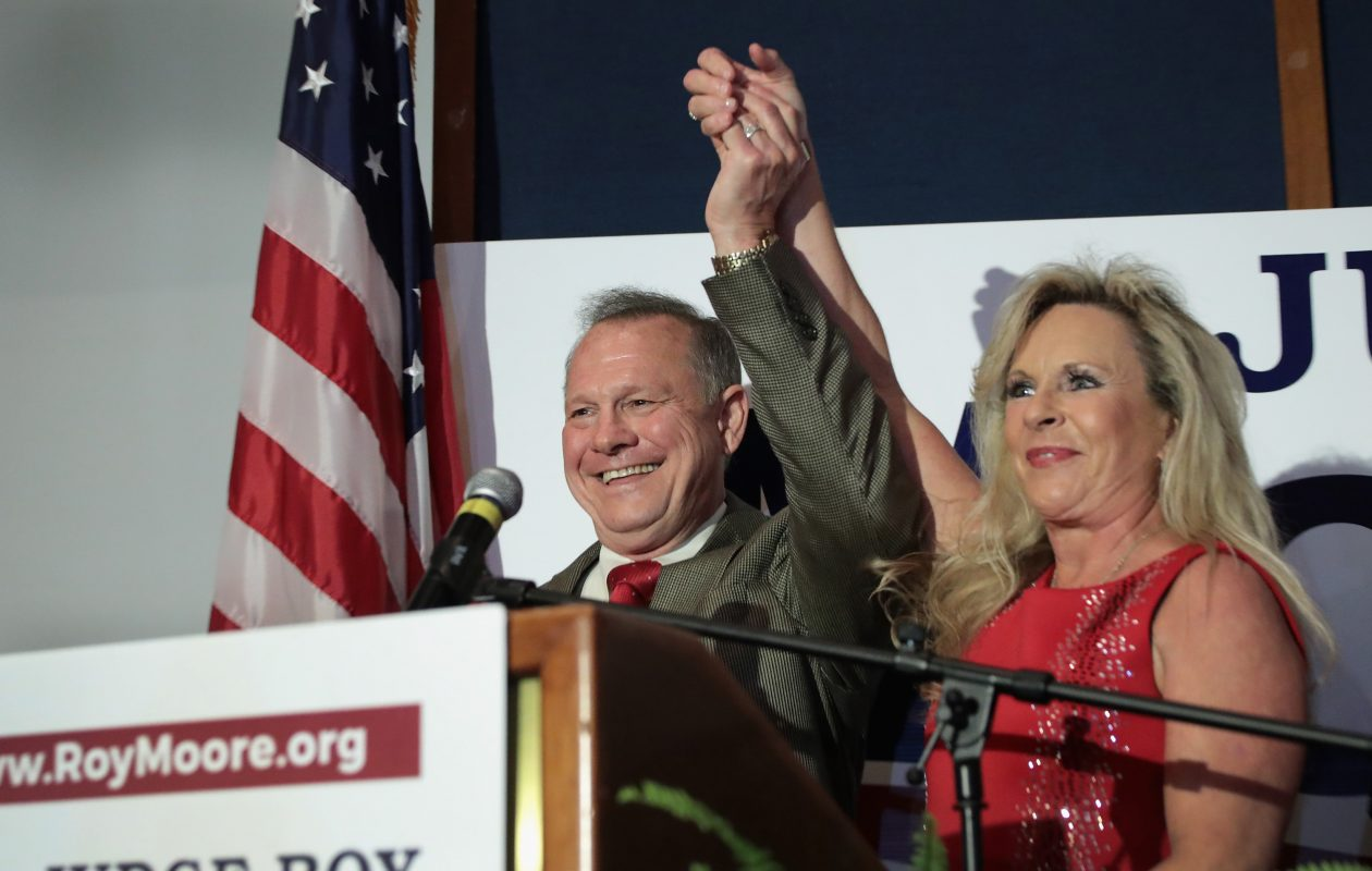 Republican candidate for the U.S. Senate in Alabama, Roy Moore and his wife, Kayla, greet supporters at an election-night rally on September 26, 2017, in Montgomery, Alabama. Moore, former chief justice of the Alabama supreme court, defeated incumbent Luther Strange in a primary runoff election for the seat vacated when Jeff Sessions was appointed U.S. Attorney General by President Trump. Moore will now face Democratic candidate Doug Jones in the general election in December.  (Getty Images)
