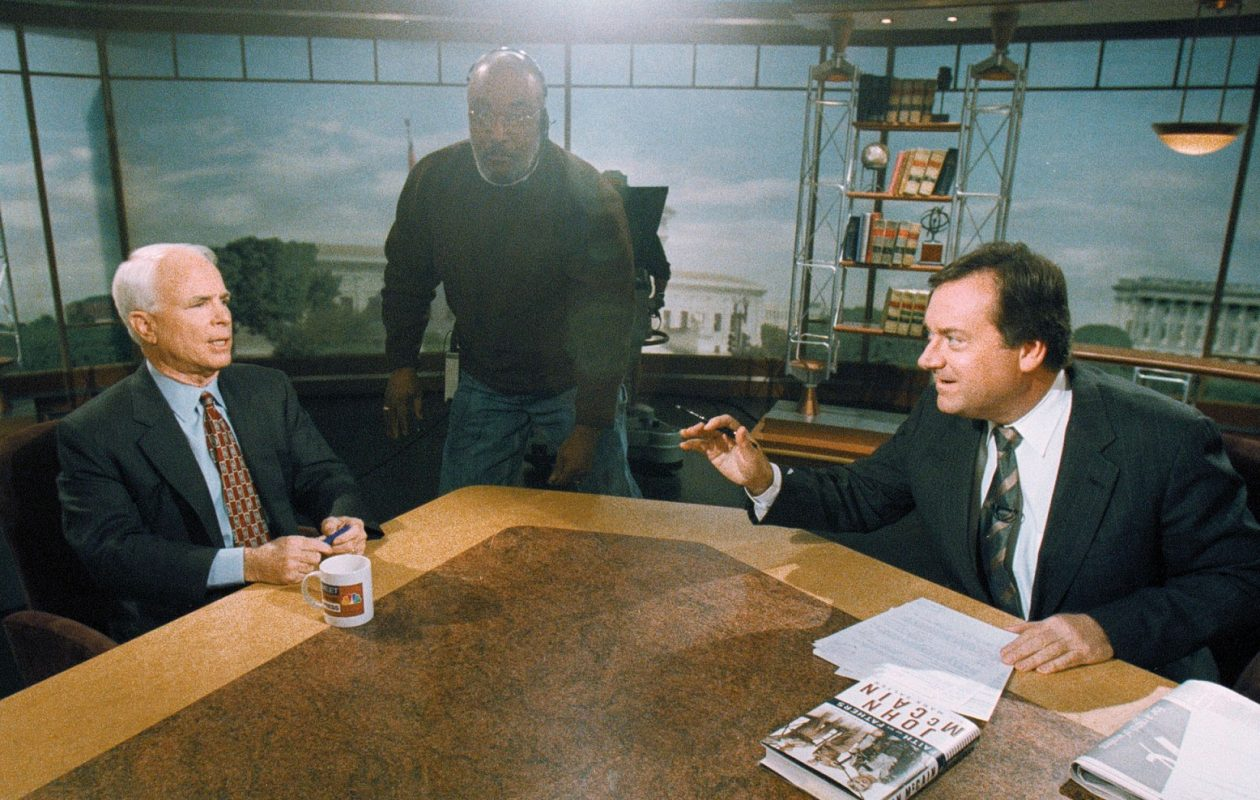 Tim Russert speaks with then-Republican presidential candidate John McCain on NBC's 'Meet the Press' October 17, 1999 in Washington DC.  (Michael Smith/Meet the Press)