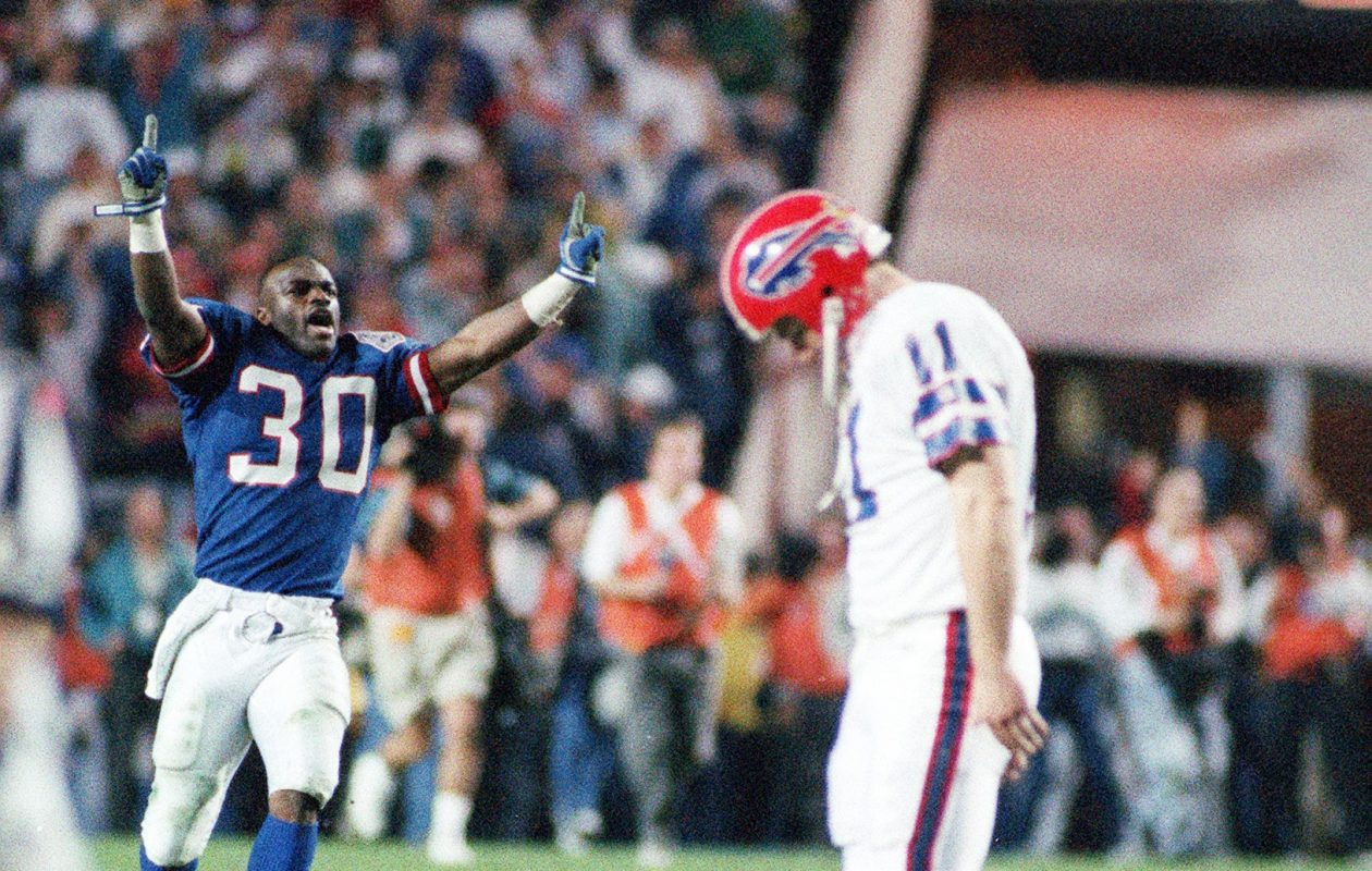Buffalo Bills kicker Scott Norwood hangs his head after missing a game-winning 47-yard field goal in SuperBowl XXV against the New York Giants on on January 27, 1991. (File photo by James P. McCoy / The Buffalo News)