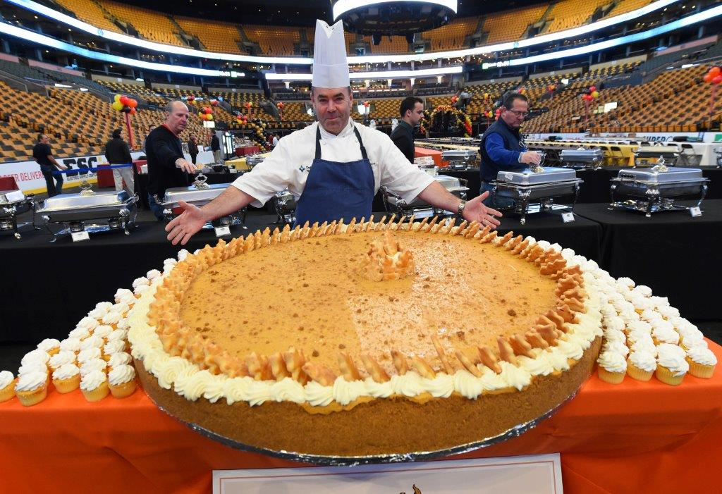 TD Garden executive chef Kevin Doherty with the 500-pound pumpkin pie for Thanksgiving Day event in Boston. (Photo by TD Garden)