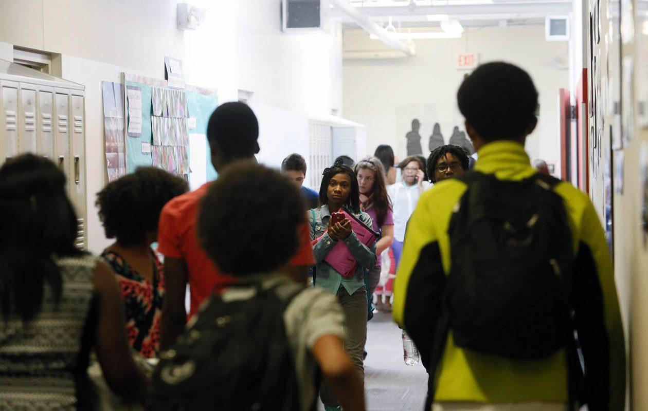 Students navigate the hallway between classes at Tapestry Charter School, Thursday, June 12, 2014. (Derek Gee/Buffalo News)