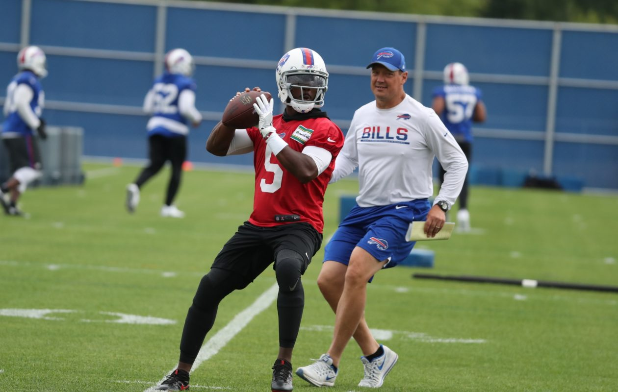 Offensive coordinator Rick Dennison works with quarterback Tyrod Taylor during a November practice. (James P. McCoy/News file photo)
