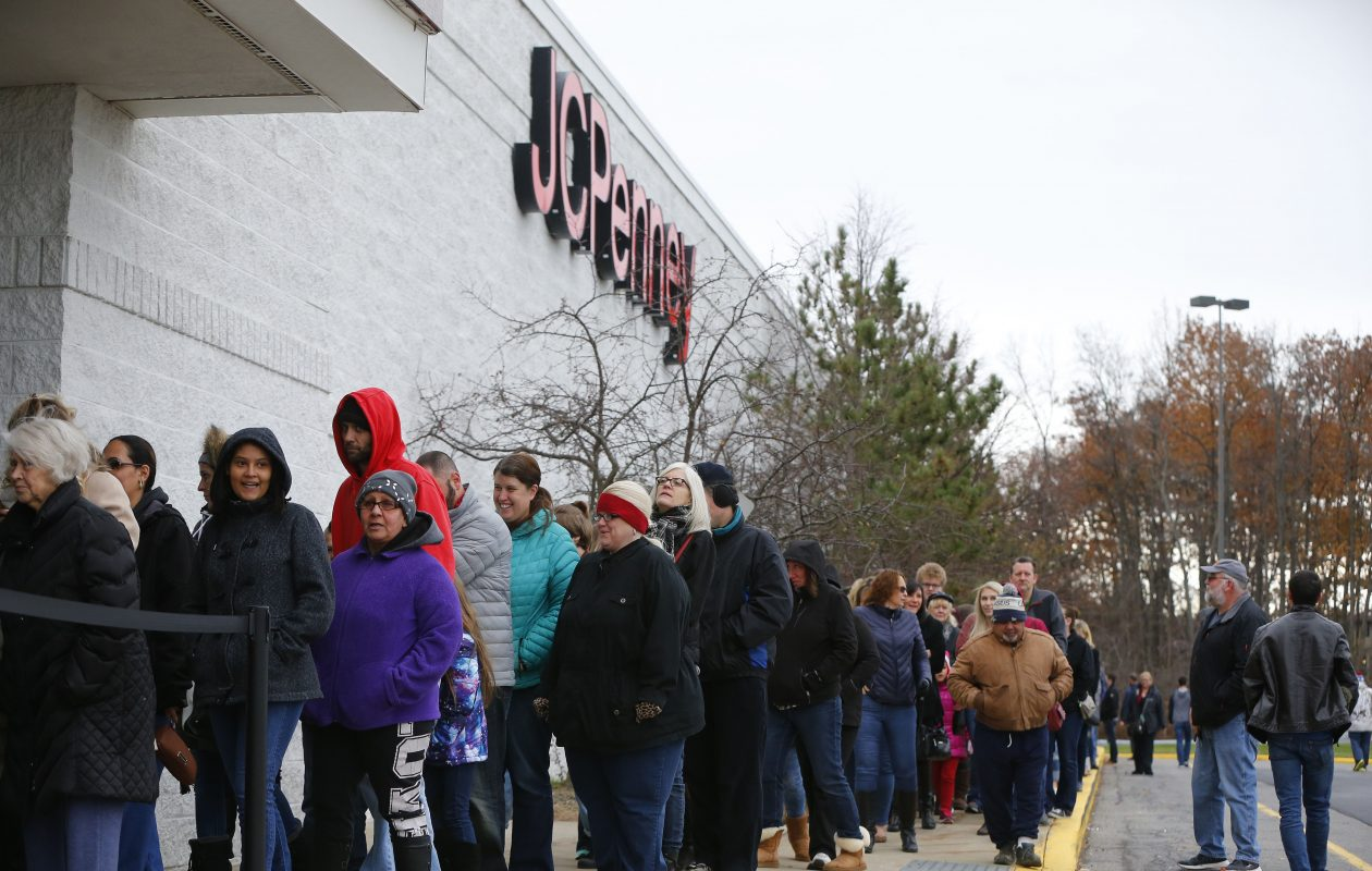 Shoppers try to stay warm as they wait in line to enter the JCPenney for Black Friday shopping at the Mckinley Mall in Hamburg Thursday afternoon, November 23, 2017.    (Mark Mulville/Buffalo News)