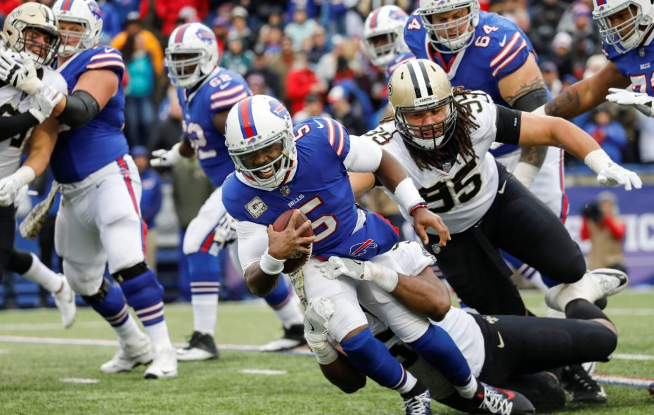 Bills quarterback Tyrod Taylor (5) is sacked by New Orleans Saints linebacker Craig Robinson during the third quarter at New Era Field in Orchard Park, Nov. 12. Taylor was benched for the Nov. 19th game against the Chargers but will start Sunday against the Chiefs.  (Derek Gee/Buffalo News)
