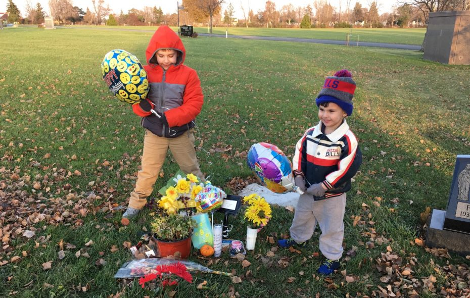 Jacob Green, 7, left, and his brother, Alexander, 4, at the grave of their mother, Amanda Green, on Nov. 20, 2017. Amanda and her husband, William, both of Buffalo, died in a fall at the Zoar Valley on Aug. 20 while hiking with their boys. The boys were also injured in the fall. (Provided by Linda Kornowski)