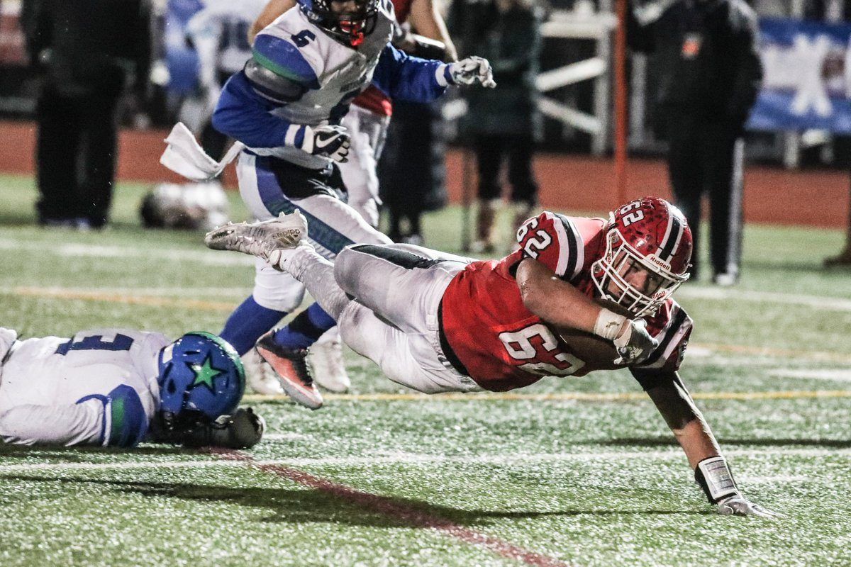 Joe Andreessen of Lancaster dives for a first down during Saturday's state Class AA semifinal contest against Cicero-North Syracuse at Union-Endicott High School. (James P. McCoy/Buffalo News)
