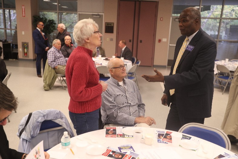 Erie County sheriff candidate Bernard A. Tolbert, right, makes his case to potential voters at a Coffee with the Candidates event at the Amherst Senior Center. (John Hickey/Buffalo News)