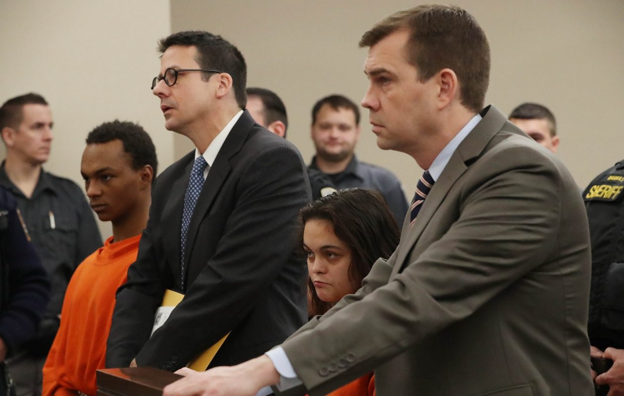 Romaine Jirdon, left, and Alexandria Heath, second from right, are accused of killing her step-grandfather Thomas Heath. Jirdon's lawyer Paul Dell, second from left, and Heath's lawyer Brian Parker, agreed to waive their clients' felony hearing on Wednesday.  (Sharon Cantillon/Buffalo News)