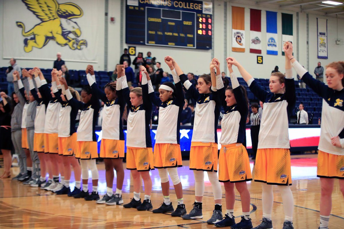 Canisius College women's players join hands and raise their arms during the national anthem on Nov. 15, 2017 (Photo: Harry Scull Jr.)