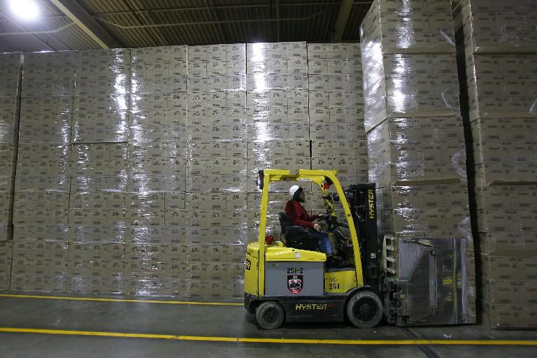 A worker moves cases of Cheerios inside the General Mills plant