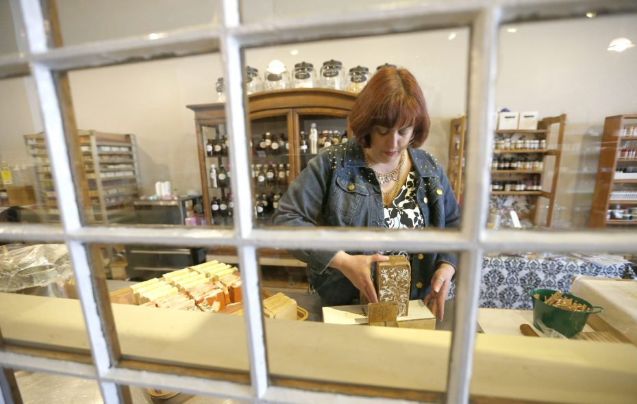 Heather Kalisiak, chief saponifier and owner of Martinsville Soapworks works in her in-store lab cutting hand made soap in NorthTonawanda on Thursday, April 10, 2014.  (Robert Kirkham/Buffalo News)