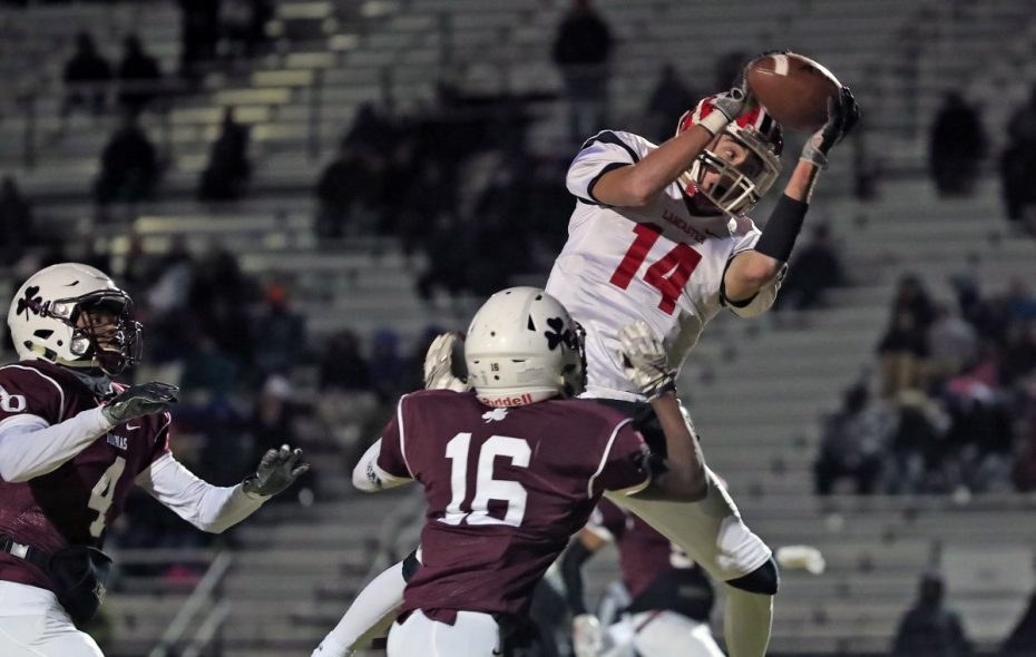 Max Giordano caight the game's only touchdown as Lancaster advanced to the state semifinals for the first time in its history. (Harry Scull Jr./Buffalo News)