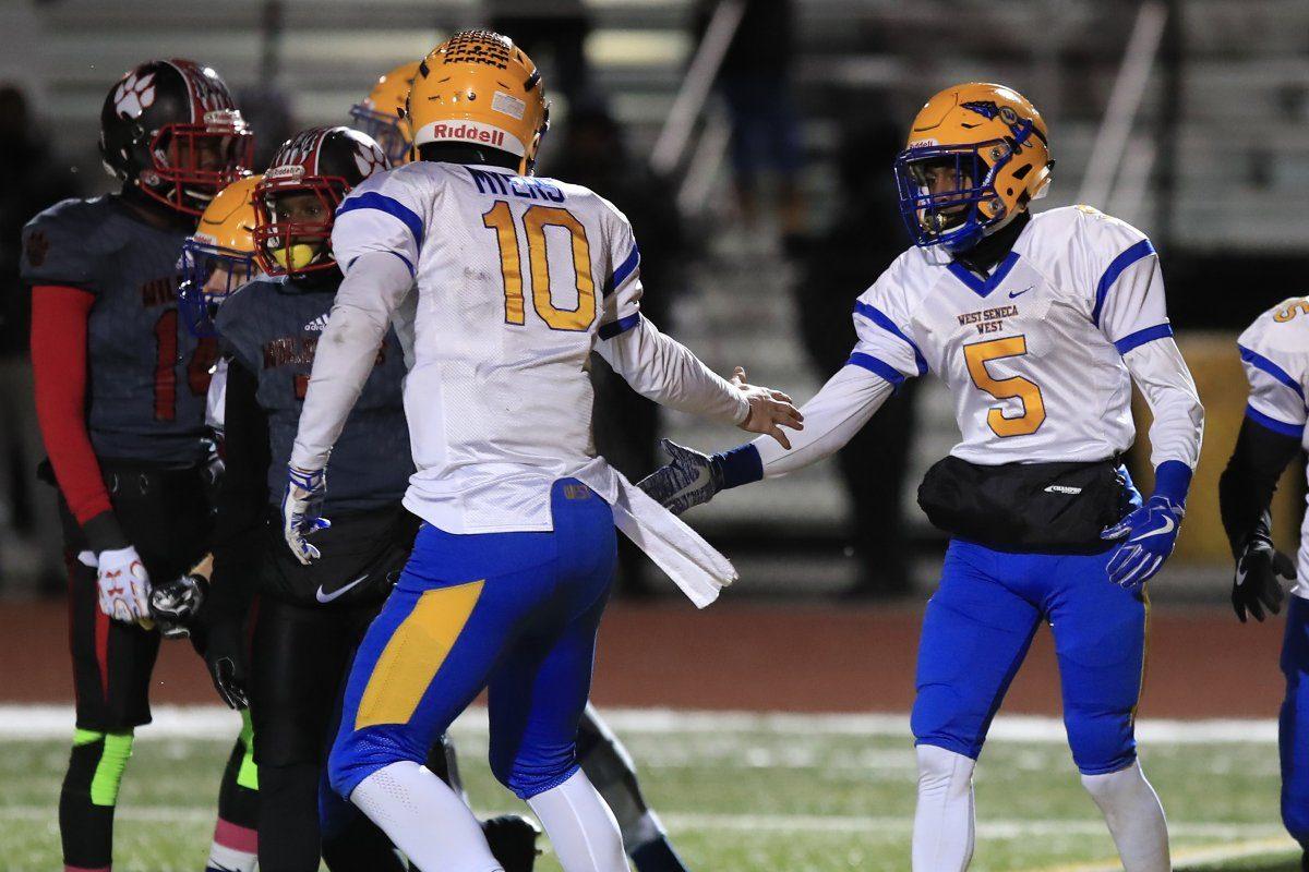 Matt Myers and Juston Johnson celebrate during West Seneca West's Class A Far West Regional triumph Friday night over Wilson Magnet. (Harry Scull Jr./Buffalo News)