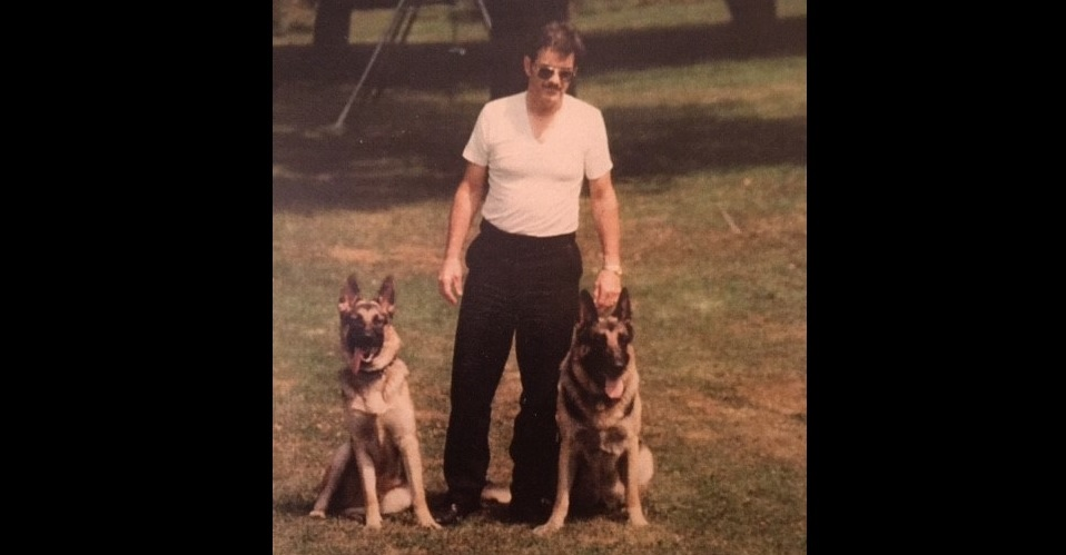 John O'Rourk, during his time as a K-9 officer with the Buffalo police, with his dogs Pepe and Casey. (Family photo)