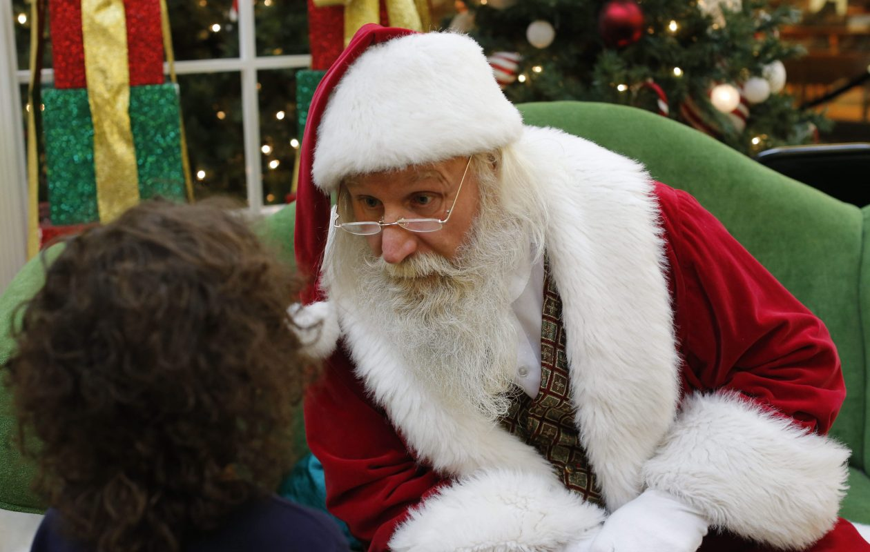 Santa Claus listens closely as a curious 4-year-old Tristen Goldring asks a question at the Walden Galleria Mall, Wednesday, Dec. 17, 2014.  Mike Stroh is a natural in the role of Santa, which he wears on and off the clock--year round.  (Derek Gee/Buffalo News)