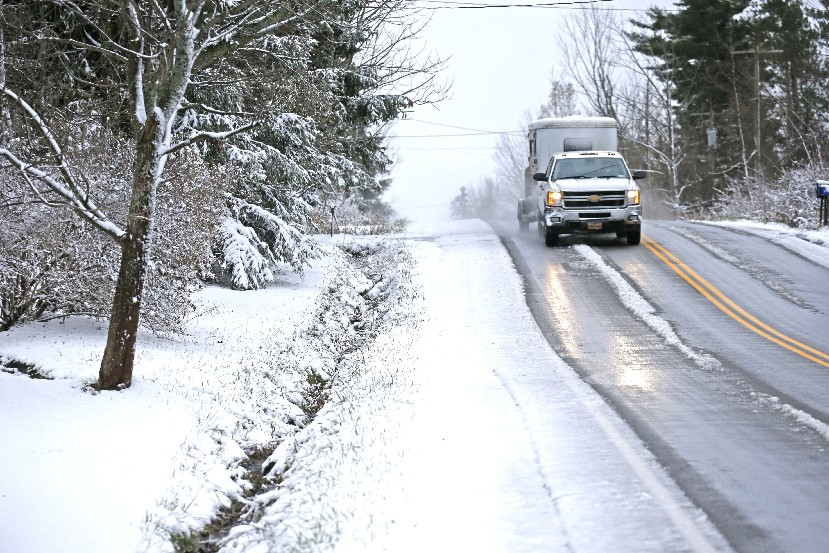 A truck pulling a horse trailer proceeds north on Center Road in the Town of Aurora with evidence of new snow that fell on Sunday. (Robert Kirkham/Buffalo News)