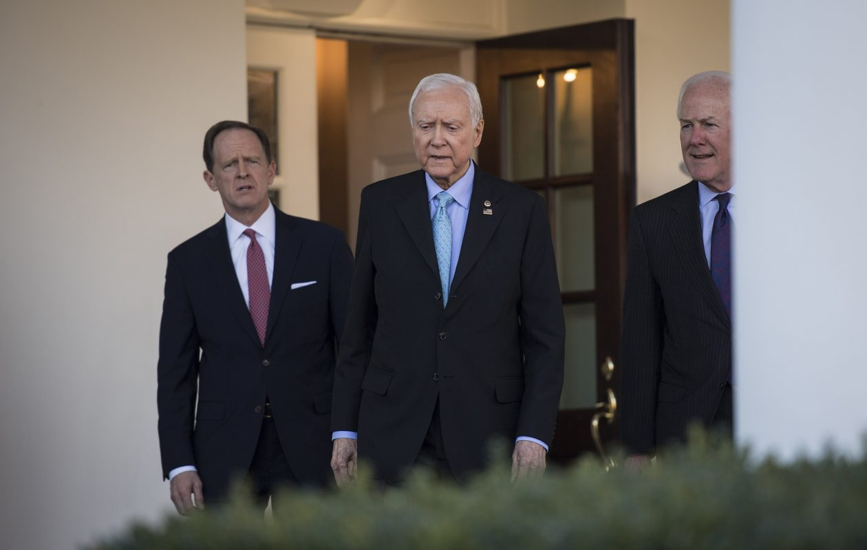 Senate Finance Committee Chairman Orrin Hatch, R-Utah, center, and Sens. John Cornyn, R-Texas, right, and Patrick Toomey, R-Pa., left, walk from the West Wing to speak to reporters after a meeting with President Trump on Monday. (Washington Post photo by Jabin Botsford)
