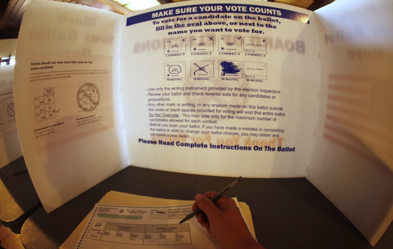A voter fills out a ballot. (Buffalo News}