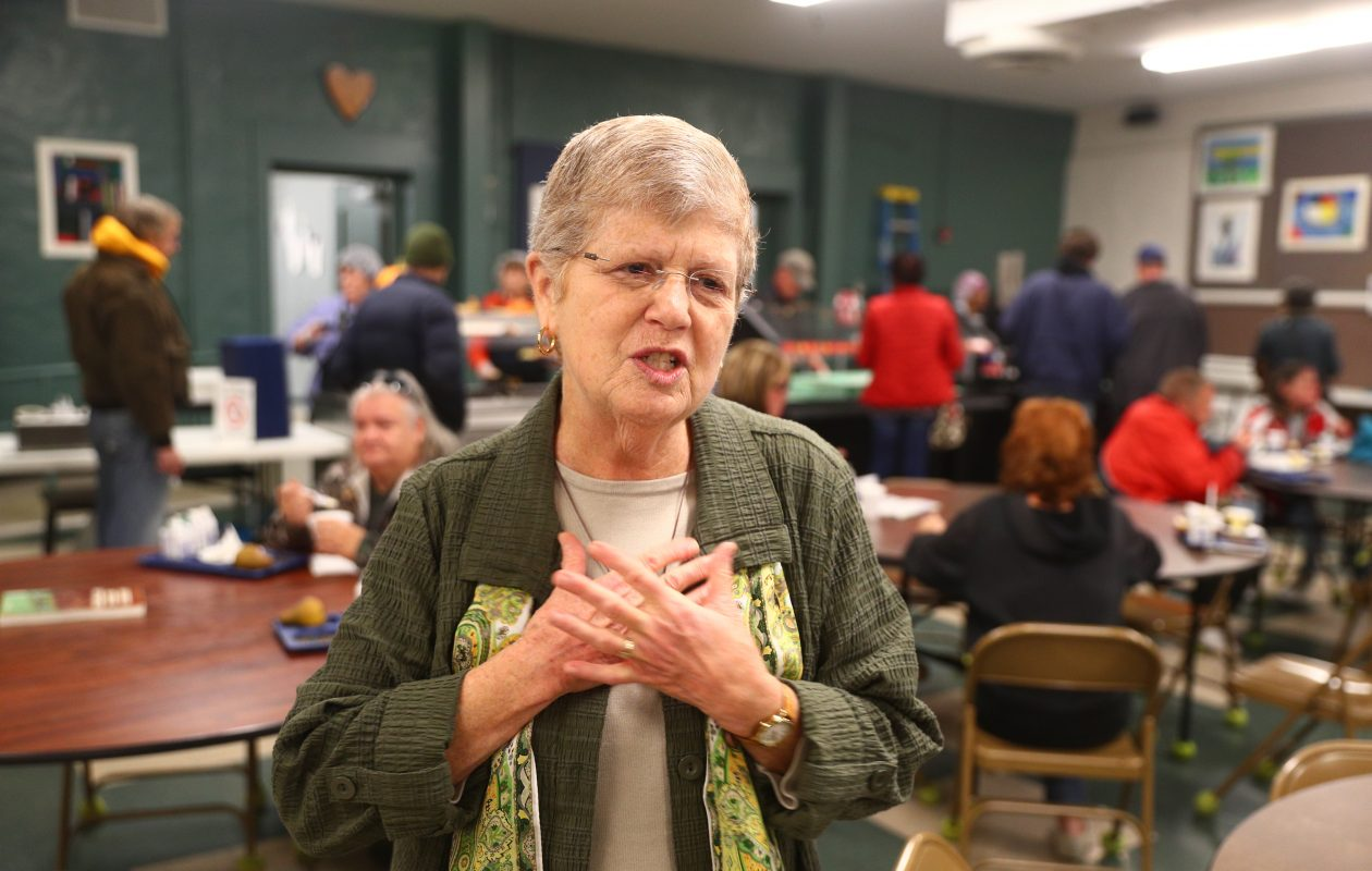 Sister Beth Brosmer, executive director, talks about her agency's mission while guests eat lunch in the dining room at Heart, Love and Soul on Ontario Avenue. (John Hickey/Buffalo News)