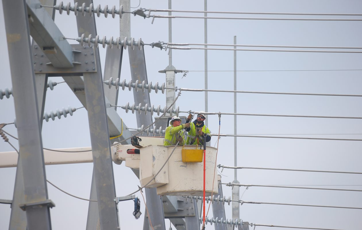 Crew members work on power lines at National Grid's project to rebuild the Gardenville Electrical Station, a $114 million investment. The station supplies about one third of the region's electricity needs. (John Hickey/Buffalo News)