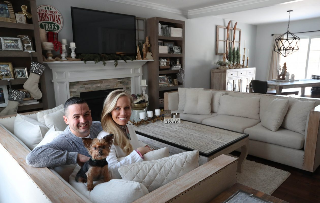 Adam and Heidie Buffomante, with their Yorkie, Daisy, have lived in their home in Amherst almost two years. (Sharon Cantillon/Buffalo News)