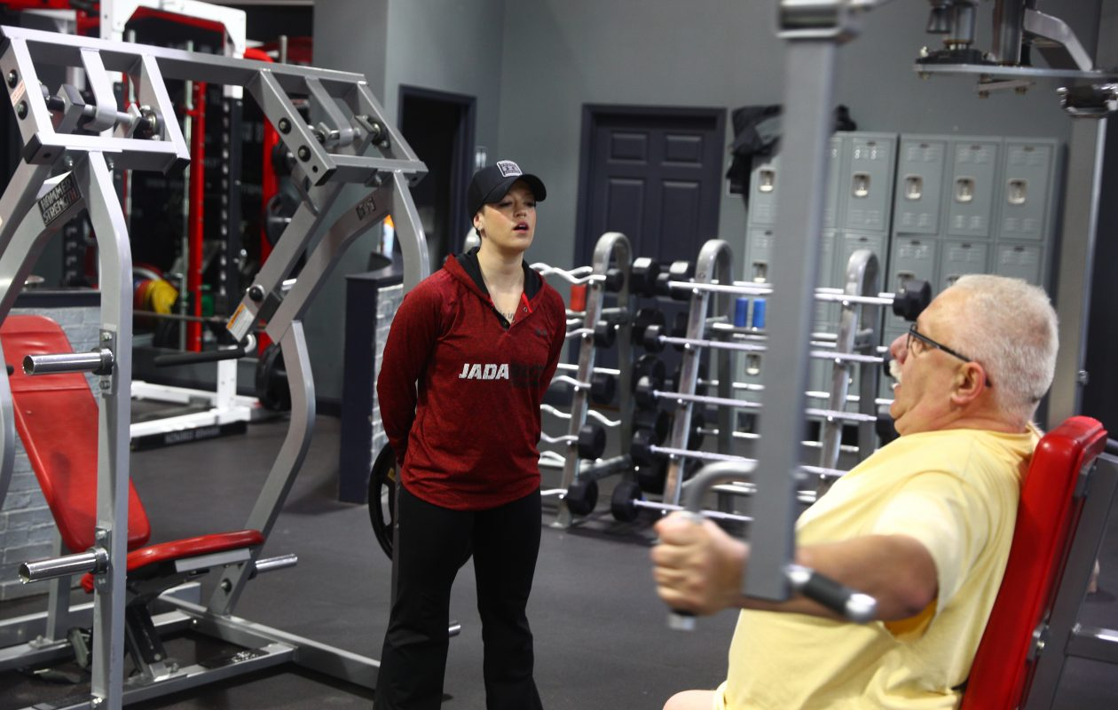 Turning a New Year's resolution into a long-term reality takes a thoughtful goal, step-by-step planning, persistence and often a guru in the area where the resolution rests, says Jada Blitz Training personal trainer Aubree Shofner, pictured working with Dan Badaszewski of Amherst. (John Hickey/Buffalo News)