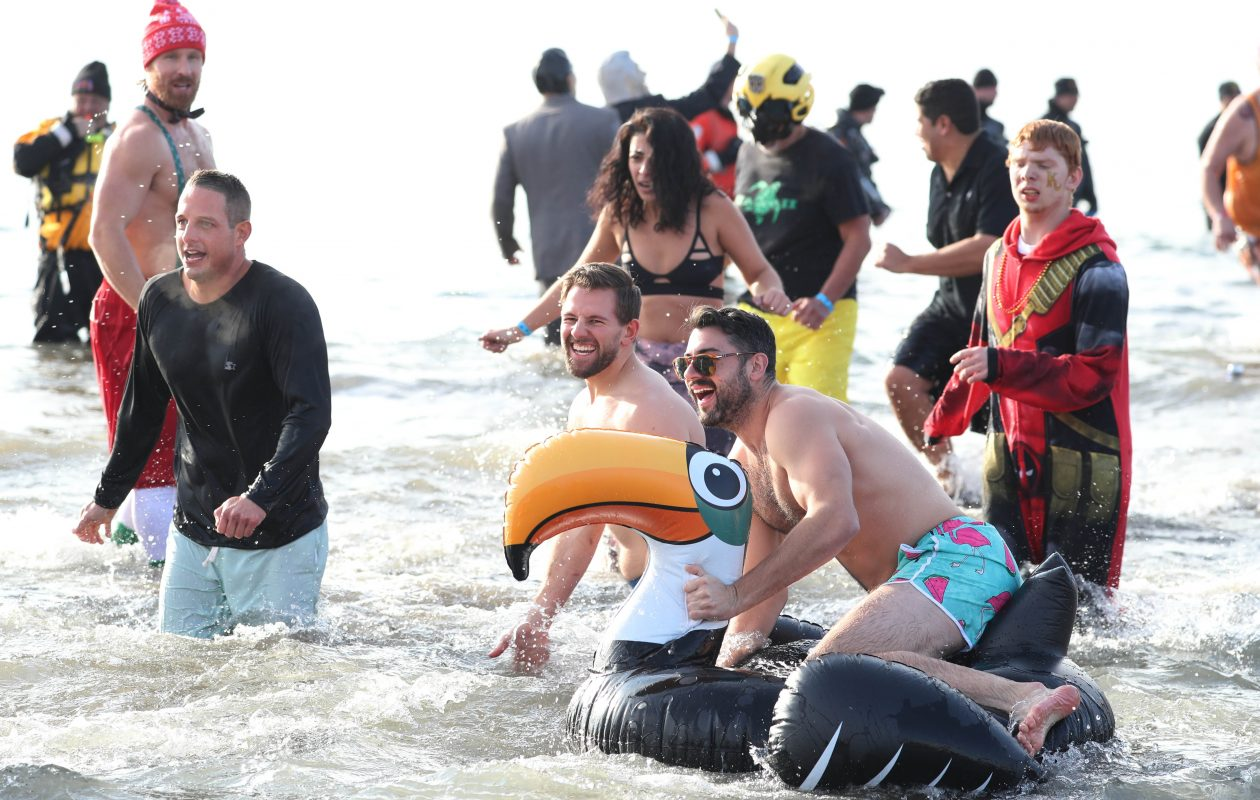 About 1,000 Western New Yorkers participated in the Special Olympics Polar Plunge at Woodlawn Beach in the Town of Hamburg, Saturday, Dec. 2, 2017. The water was 48 degrees, about the same temperature as the air on a particularly warm December day.  They anticipated raising $150,000 to benefit Special Olympics athletes. (Sharon Cantillon/Buffalo News)