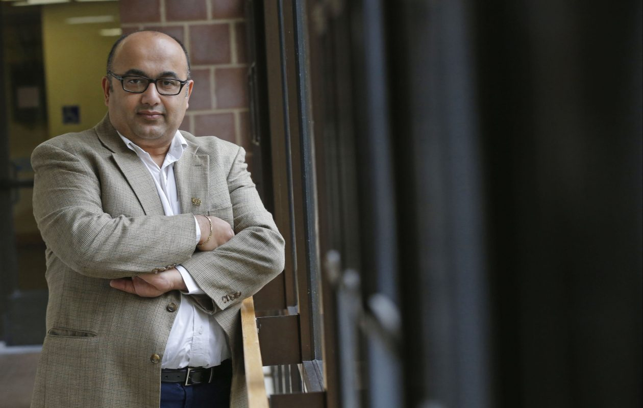 Prasad Balkundi, chair and associate professor at UB Management School on UB's north campus, says many companies have undercut their human resources departments.  (Robert Kirkham/Buffalo News)
