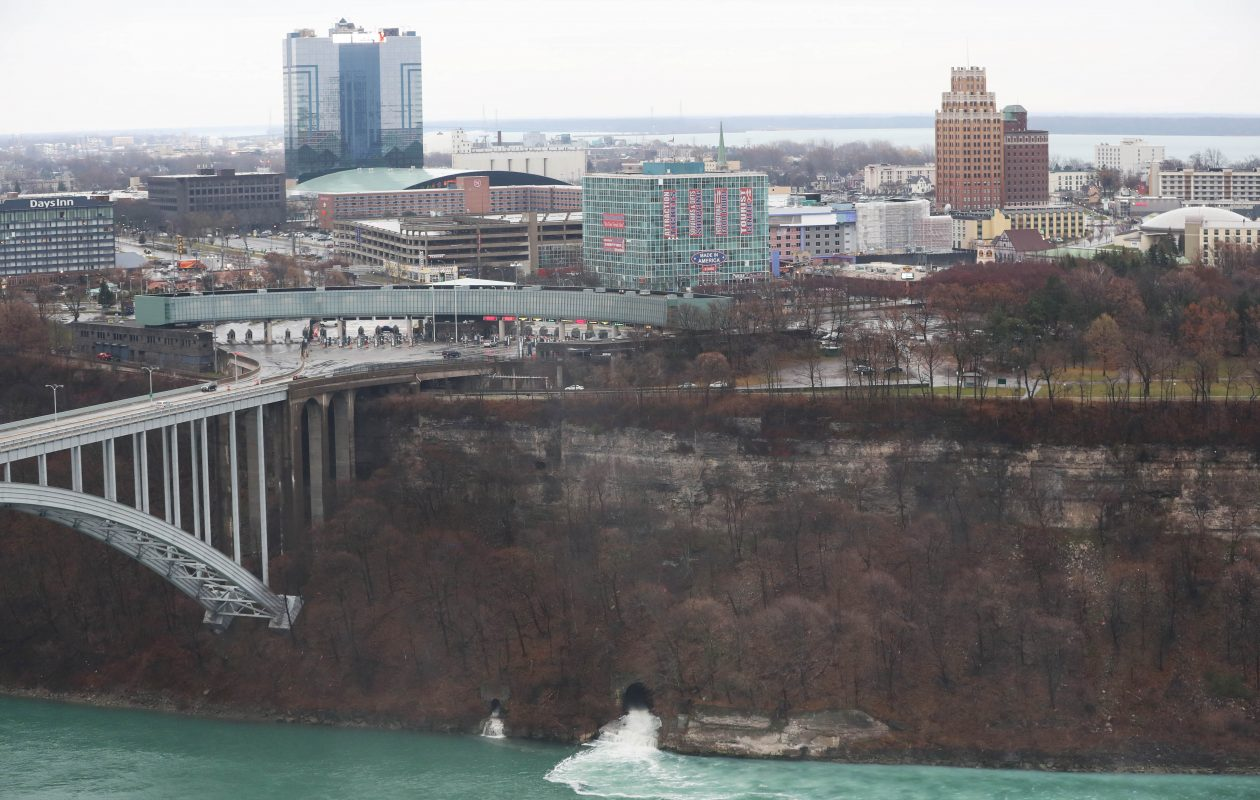 This November 2017 view of Niagara Falls, N.Y., taken from the Canadian side, shows treated sewage pouring into the Niagara River Gorge from a tunnel above the waterline. (Sharon Cantillon/Buffalo News)