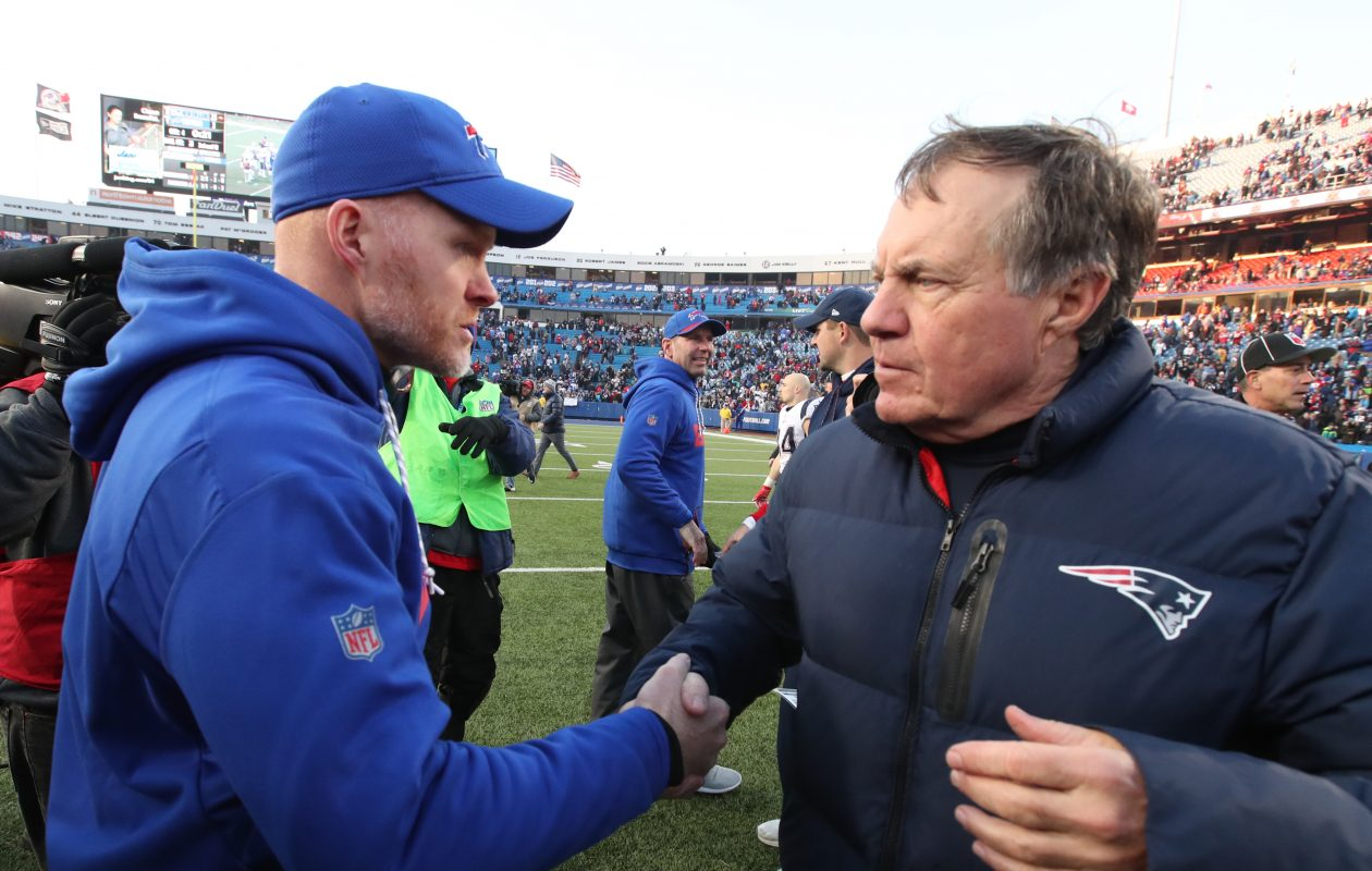 Buffalo Bills head coach Sean McDermott shakes hands with New England Patriots head coach Bill Belichick in the middle of the field at the end of the game at New Era Field on Sunday, Dec. 3, 2017. (James P. McCoy/Buffalo News)