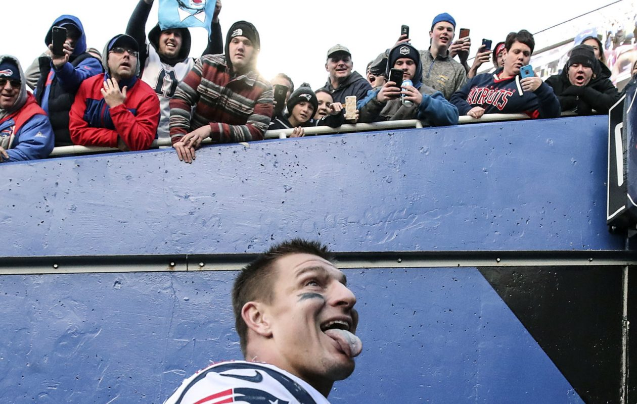 An unapologetic Rob Gronkowski sticks his tongue out at fans as he leaves New Era Field on Dec. 3. (James P. McCoy / News file photo)