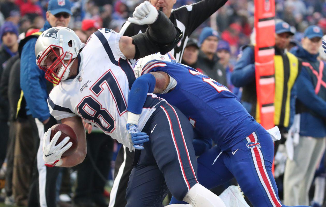 Jordan Poyer tackles Rob Gronkowski. (James P. McCoy/Buffalo News)