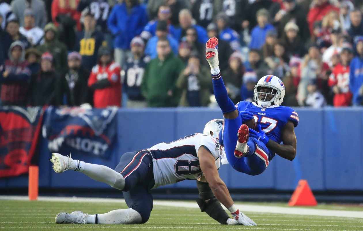 Following this interception by Bills cornerback Tre'Davious White, Patriots tight end Rob Gronkowski delivered a vicious late hit that earned him a one-game NFL suspension Monday. (Harry Scull Jr./News file photo)