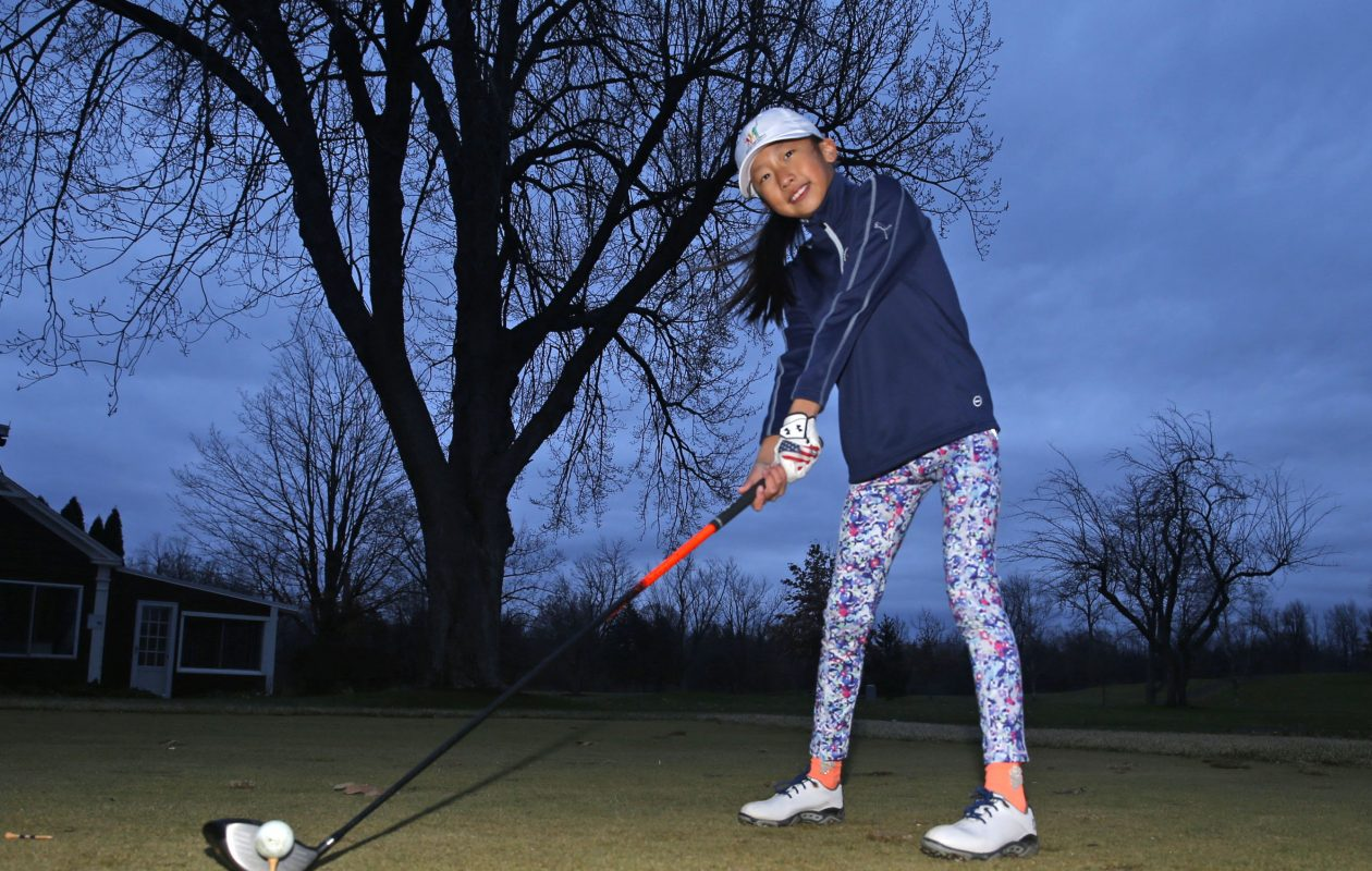 Lily Zhang, 9,  of Williamsville, is a finalist in the Drive, Chip &  Putt national finals.  She tees one up at Park Country Club on Dec.  5. (Robert Kirkham/Buffalo News)