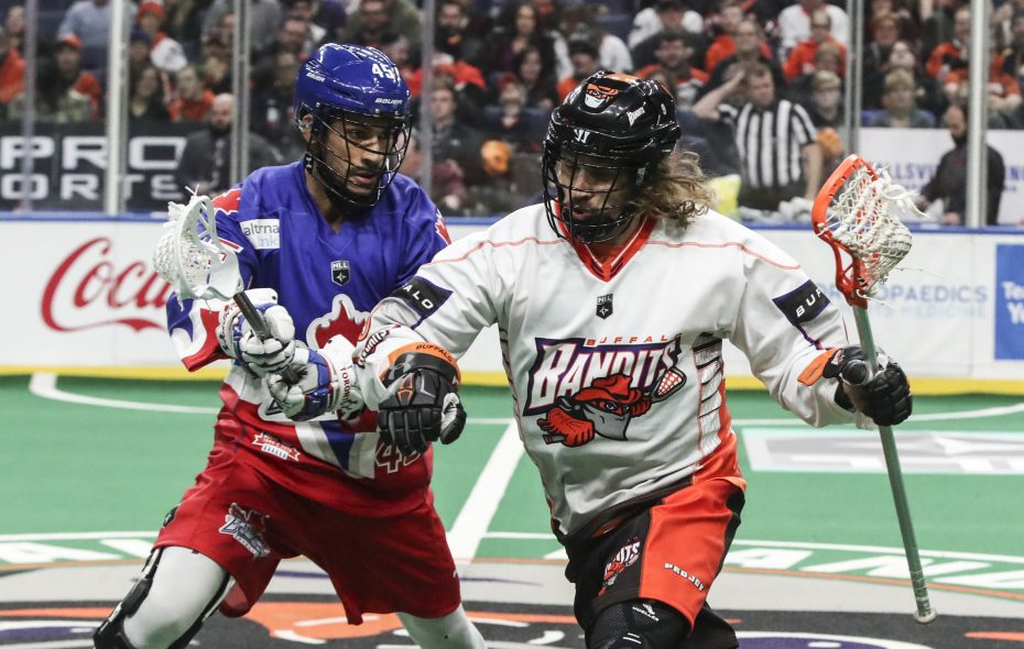 Buffalo Bandits' Mark Steenhuis runs up the field with the ball past Toronto Rock's Damon Edwards at KeyBank Center on Friday, Dec. 8, 2017. (James P. McCoy/Buffalo News)